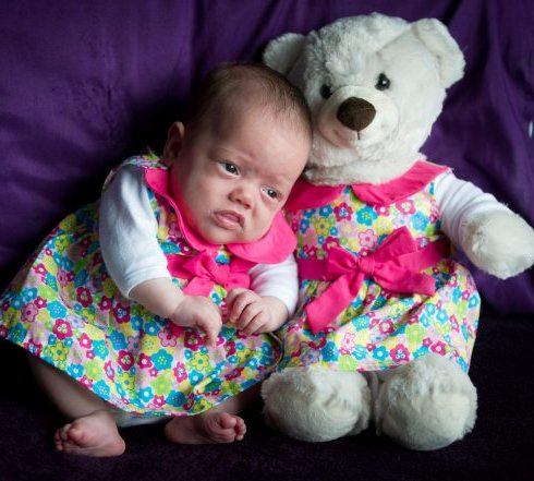 Premature baby wears teddy bear clothes as she is too tiny
